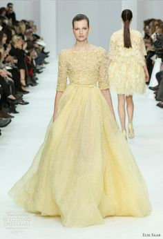 Elie Saab Spring/Summer 2012 Couture collection, an absolutely delightful collection of gowns in a gentle, pastel palette reminiscent of all things delicious and lovely — macarons, dragees and cupcake frosting. Totally loving it! Above, white and pink wedding dress; below, butter cream yellow gown.