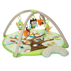 Treetop Friends - Activity Gym: Our adorable ACTIVITY GYM features soft linen and patterned arches and includes a matching supportive Tummy Time pillow. Five hanging toys attach to 13 easy-to-hang loops offering irresistible multi-sensory play for baby at every stage of development. A mirror and built-in sounds and textures on the mat add to the fun.