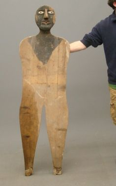 Folk Art Sculpture- Great Early 20th c. folk art wooden figure of a man. Super folky with metal nose!  Almost 5 feet tall.