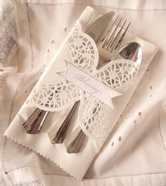 Table Blessings. Twelve Doily Wrapped Dinner Place Settings with Custom Wording.