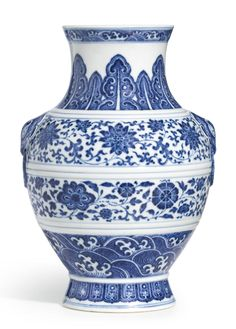 A BLUE AND WHITE VASE, HU JIAQING SEAL MARK AND PERIOD of archaistic hu form, well painted in brilliant cobalt-blue tones with simulated 'heaping and piling', the baluster body encircled by two bands, the upper with continuous lotus scroll, the lower with a composite floral meander, all between slightly raised double-line borders, the shoulder set with animal mask and mock-ring handles, below the waisted flared neck decorated with ruyi-bordered stiff upright plantain leaves and a narrow wave…
