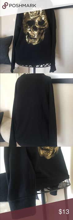 Gold skull sweater Men's sweater size large slim fit. I personally love it. I think it looks great on women too!! I would say it's equivalent to a women's large since it's slim fit. marc ecko Sweaters