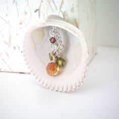 Would like prettier shell. Live by beach so tjese seem common. swarovski crystal // shell pendant // handmade jewelry__KimberlyAnnMarie