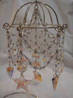For those of you who want to make a decorative miniature chandelier, here's how I did it. No, I haven't found a way to comprise a light bulb in it so it's strickly for decoration. Once I know how t...