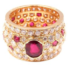 CARTIER Yellow Gold Ruby and Diamond 'Panther' Ring, ca. 1980s