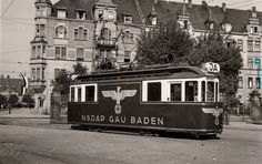 """German trolley car during the Third Reich; painted on the side, the Nazi eagle emblem and """"NSDAP Gau Baden""""; propaganda in the Baden area"""