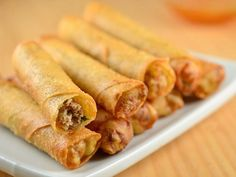 Lumpia Shanghai (Meat-filled Spring Rolls). We have a guy who stops by work whose wife makes these. Unbelievably delicious and addictive. Filipino Dishes, Filipino Recipes, Asian Recipes, Ethnic Recipes, Filipino Food Party, Lumpia Recipe Filipino, I Love Food, Good Food, Yummy Food