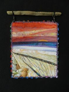 Sailors Delight.  Small art quilt hanging from found driftwood.  Red sky at night.....