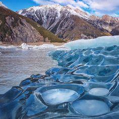 Tasman Lake, NZ. How amazing is this flipped iceberg that broke off the Tasman Glacier?