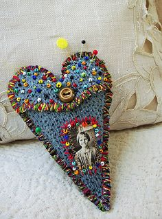 pinning for inspiration - I can see a denim heart shaped pillow (maybe more rounded style) with b/w or perhaps handcolored photo on it, narrow lace trim, I like the idea of adorning with buttons. MAY do flower embroidery with buttons as centers, but I'm thinking just the buttons ...