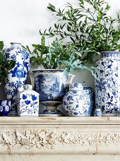 Design Challenge: 5 of Our Stylists Take on Blue & White | gorgeous blue and white Chinoiserie porcelains on an elegant stone mantel