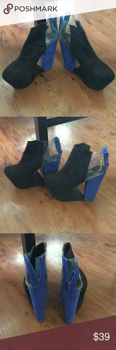 Black n Blue heels Very comfortable platform black and blue heels. 5 in heel. Suede material. Coolest shoes ever. Worn few times. Statement shoes. privileged Shoes Platforms