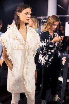 White wool frayed jacket backstage at Isabel Marant SS15 PFW. More images here: http://www.dazeddigital.com/fashion/article/21965/1/isabel-marant-ss15