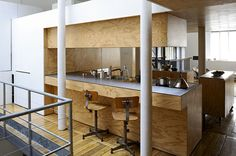 "A new twist on ""industrial"" interiors: a plywood kitchen in Paris"