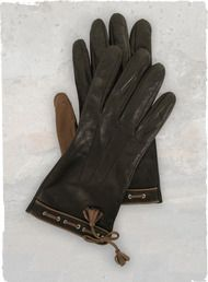 The two-toned, silk-lined gloves in buttery soft olive and saddle Italian leather, with contrast stitching and tassels.