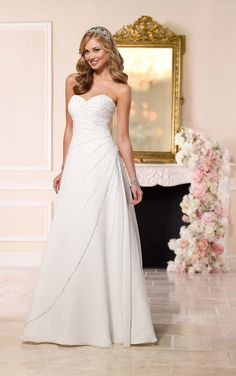 This regal wedding dress from Stella York features eye-catching sprays of elegant Diamante beading on a fine Capri chiffon A-line silhouette.