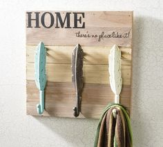 Make a stylish scarf or coat rack with these Metal Feather hooks, vinyl letters on a rustic wood board. Easy instructions can be found on the Craft Warehouse Create page. #diy #rustic #organize #craftwarehouse craftwarehouse.com