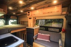 This van conversion was built for taking extended weekend trips, with a double drop down bed, large kitchen galley, and a modular bench seat with a dog bed. Van Conversion Build, Van Conversion Interior, Camper Van Conversion Diy, Campervan Interior, Rv Interior, Motorhome, Truck Camper Shells, Tiny House Big Living, Rv Living
