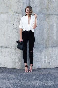 Black and white outfit. Blak ankle pants and deep V shirt
