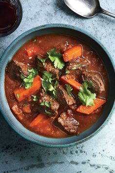 This beef stew recipe incorporates star anise, lemongrass, fish sauce, shallots, ginger, garlic, crushed tomatoes, carrots and cilantro to create the ultimate comfort food meets fall recipe.#fallrecipes #stewrecipes #souprecipes #beefstew #beefstewrecipes #falldinners