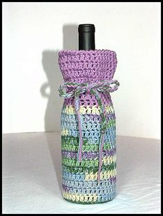 Wine Bottle Cozies - third group (45) made from various worsted weight acrylic yarns.