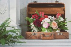 Brown vintage briefcase displaying JL Designs, Jackson Shrub at Wes Anderson inspired wedding with Bash, Please, at the Vibiana in Los Angeles with Found Vintage Rentals