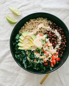 quinoa burrito bowl- quinoa, kale infused with lime, black beans, pico de gallo, avocado, chipotle tahini dressing.