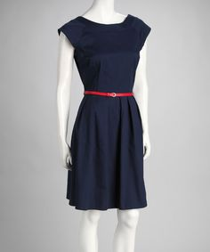 A slender red belt brings a pop of color to this cleanly styled dress, while a flared skirt floats away from the gently pleated waistline to create a look that's polished and feminine.