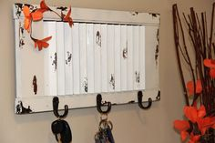 DIY Upcycled Shutter Key Rack - This is a great tutorial on turning an unused and discarded window shutter and turn it into this useful and beautiful key rack!