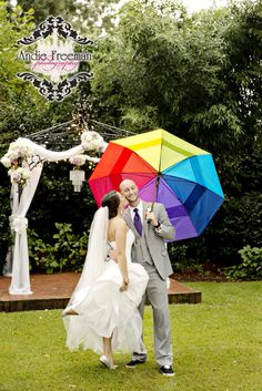 Bride and groom portrait with umbrella. Classic Southern Fall Wedding. Rainy day wedding. Rain wedding. Photography:  Andie Freeman Photography, www.TheAthensWeddingPhotographer.com Wedding Coordinating:  Wild Flower Event Services Venue and Floral:  The Thompson House and Gardens, Bogart, GA  Entertainment:  Dynamite Entertainment Make-up:  Bombshell Creations www.BombshellCreations.com