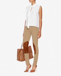 Derek Lam Jodphur Leggings: Camel: Crisp seaming meets a classic equestrian silhouette with these smart leggings. Button/hook/zipper closure. Mini flap frontal pocket. Two zip pockets at back. 5 1/2 hidden zips at cuffs. In camel.   Fabric: 90% wool/8% nylon/2% lycra Combo: 100% lambskin ... $1,150