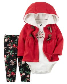 She's warm all winter in this cozy cardigan featuring a toggle button design. Complete with a festive coordinating bodysuit and pants.