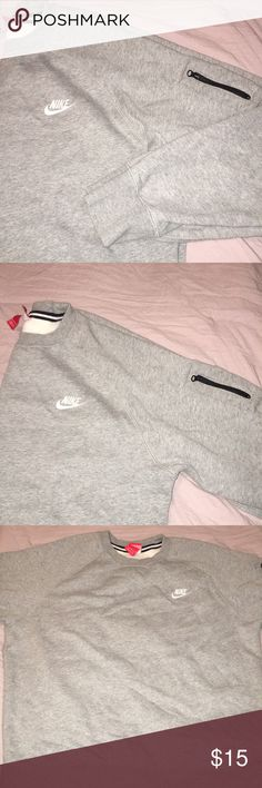 Nike Pullover Great condition!  No tears or stains.  Has key-pocket w/ zipper on left arm. Nike Tops Sweatshirts & Hoodies