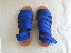 Cobalt Blue leather strap sandals. Closes by nit around the ankle. Women shoes for summer.