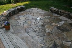 Granite Patio with Dry-Laid Fieldstone Sitting Walls