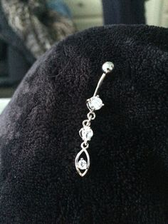 Clear dangly belly button ring.