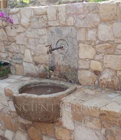 Antique wall stone fountain. Photo by AncientSurfaces.com call us at: (212) 461-0245