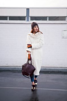 Negin Mirsalehi is wearing a coat and jeans from Zara, top and hat from Filippa K, bag from Alexander Wang and the shoes are from Marni