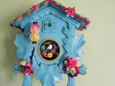 Painted cuckoo clock... If I find myself in possession of a clock from my parents some day, it will need to be painted. So pretty!