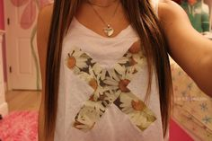 Super cute I love the sunflowers they just add that special touch to the plain white tank top