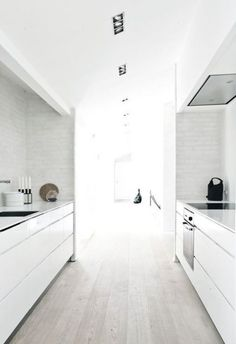 Modern Interior Properties in a Traditional Exterior Design of the Fredensborg House, by NORM Architects Galley Kitchen Design, Galley Kitchens, New Kitchen, Kitchen White, White Kitchens, Narrow Kitchen, Kitchen Wood, Kitchen Drawers, Kitchen Cabinets