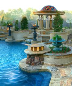 Stunning pool with luxurious decor~§Joe DiPaulo – Stone Mason