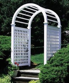 Custom Garden Arbor - Simple stone steps are transformed into an elegant garden entranceway with the addition of a special cellular PVC Stamford spindle top arbor.