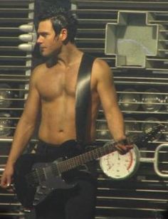 Richard Z. Kruspe, guitarist of Rammstein. Just look at those abs, plus he's a master on guitar, hot damn! (melts) ;D