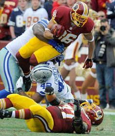 Description of . Washington Redskins tight end Jordan Reed (86) is stopped by Dallas Cowboys defensive tackle Henry Melton, left, and strong safety Barry Church (42) during the first half of an NFL football game in Landover, Md., Sunday, Dec. 28, 2014. (AP Photo/Richard Lipski)
