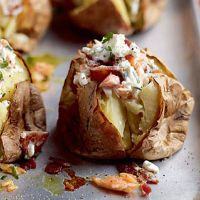 Speedy jacket potatoes with crispy bacon and salmon. A cheap and easy midweek dish, on the table in 30 minutes.