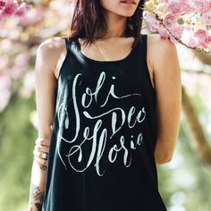Glory to God alone! This beautiful handcrafted design is printed on black triblend and is a loose-fitting, flowy women's tank top. The perfect summer outfit that's always comfy. *This soft tri-blend m