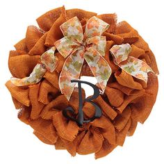 Burlap wreath with a leaf-adorned ribbon in a natural twig base. Burlap Ribbon, Burlap Wreath, Outdoor Thanksgiving, Autumn Leaves, Autumn Fall, Printed Ribbon, Joss And Main, Fall Pumpkins, Leaf Prints