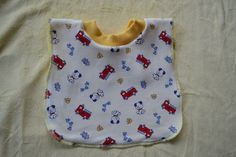 Baby Bib with Stretchy Neck for ease of putting on Baby:  Available at www.BeBeBuntingBoutique.com