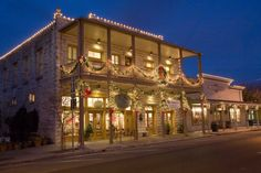 Traditional holiday decorations on the historic buildings downtown Fredericksburg, Texas help give the Christmas celebration a German flavor. Part of the Texas Hill Country Regional Christmas Lighting Trail. Photo: Trish McCabe-Rawls/Fredericksbur, Courtesy Photo / SA